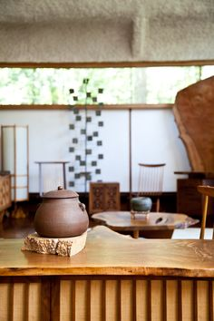 George Nakashima studio | Beautiful ceramic and iron pieces displayed on cabinets and coffee tables around the studio.