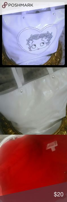 Betty Boop? purse/tote bag Looks leather but is not. Never used, have a scratch that's small and a small tear on the side, shown in pictures?. This is a lightweight bag or purse however you choose to use it. Bags Shoulder Bags