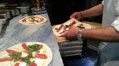 Preparing the Pizza San Marzano.  Marechiaro Pizza Mykonos