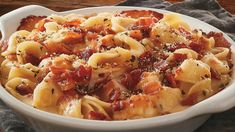 Fazoli's adds a new pasta dish to the menu with the introduction of the new Smoky Bacon Pasta Bake. The Smoky Bacon Pasta Bake features orecchiette pasta topped with rich and creamy smoked gouda cheese . Gourmet Recipes, Vegetarian Recipes, Healthy Recipes, Vegetable Casserole Healthy, Bacon Pasta Bake, Smoked Gouda Cheese, Smoky Bacon, Baked Vegetables, Easy Cooking