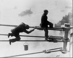 Brooklyn Bridge painters at work high above the city, on December 3, 1915