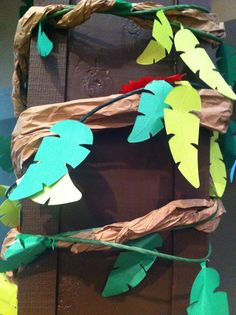 Saw these cute decorations at a church day camp program. Great for jungle, amazon and/or luau theme parties!  It's brown paper, rolled to imitate vines with green/brown vines, attached with flowers on a fuzzy twisters or leaves (taped on the thinner vines)