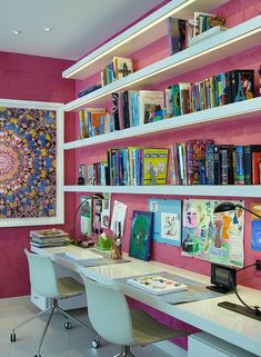 pink walls and a mosaic wall art make this nook more eye catchy