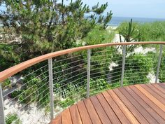 Curved ipe deck with the Ithaca style railing.