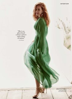 Dressed in green, Isla Fisher wears Maria Lucia Hohan dress and Giuseppe Zanotti heels
