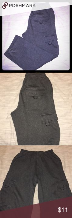 Men's gray drawstring cargo sweatpants Men's gray Cargo Sweatpant with drawstring 100% Acrylic. Very thick and warm gently worn and wash few times. 2 side pockets, 2 cargo pockets and 1 back pocket. No stain. No tear. Good condition  ⭐️(Bundle and save)⭐️ 21 pro USA Sportswear Pants Sweatpants & Joggers