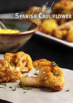 Pan Fried Spanish Cauliflower Tapas - These breaded fried cauliflower bites are a simple and tasty tapas dish you should make at your next get-together! Just a quick dunking in egg and breadcrumbs and a minute in a skillet and you are all done. Can be made ahead and reheated! | justalittlebitofbacon.com