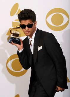 """Musician Bruno Mars, winner of the Best Male Pop Vocal Performance award for """"Just The Way You Are"""" poses in the press room at The 53rd Annual GRAMMY Awards held at Staples Center on February 13, 2011 in Los Angeles, California."""
