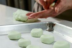 Roll the peppermint pattie dough until each one is smooth.