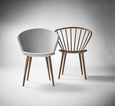 The Miss Holly Klädd Chair designed by Jonas Lindvall updates the popular dining room seating with a soft fabric upholstery that enhances the design's comfort and versatility.