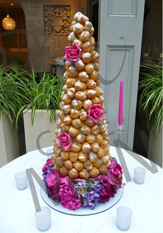 Pink and purple croquembouche.