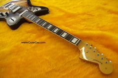 Crafted in Japan Fender Jaguar headstock and bound fret board with block inlays.