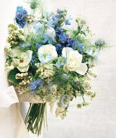Bridal bouquet - We <3 this blue + white bouquet made of nigellas, delphiniums, viburnum berries, and sweet peas