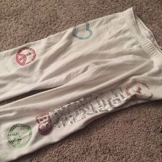 Victoria secret bling sweats see photos! Size large very comfy but some stains shown on front and back leg Victoria's Secret Pants