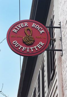 River Rock Outfitter, historic downtown Fredericksburg, VA.  Routed HDU Sign panel and lettering with hand carved HDU knot detail, all hand painted and mounted with a custom hanging bracket