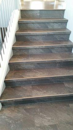 Luxury Vinyl Tile Installed With Custom Insert Stair Nosings.
