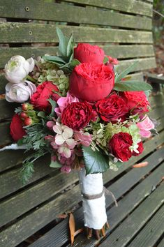 Fall bridal bouquet with old fashioned roses, ranunculus, berries, and gray foliage by Willow Oak Farm