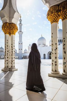 Woman walking at Sheikh Zayed Grand Mosque, Abu Dhabi, United Arab Emirates by Gable Denims Abu Dhabi, Beautiful Hijab Girl, Blend Images, Niqab Fashion, Muslim Hijab, Anime Muslim, Mekkah, Arab Girls Hijab, Cute Friend Pictures