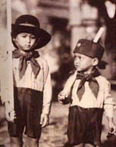 King Bhumipol Adulyadej (Rama IX) the great(R) and him brother King Ananda (Rama VIII) (L) wear scout uniform when them young.
