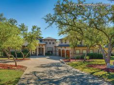 Stunning Hacienda home | house in Garden Ridge with beautiful architecture, lovely trees and landscaping, with dramatic ceilings, quality millwork, and graceful arches.