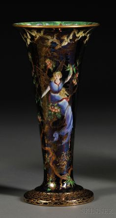 Wedgwood Fairyland Lustre Trumpet Vase, England, c. Butterfly Women to a black sky, the interior in mother-of-pearl with Floating Fairies border, printed mark.
