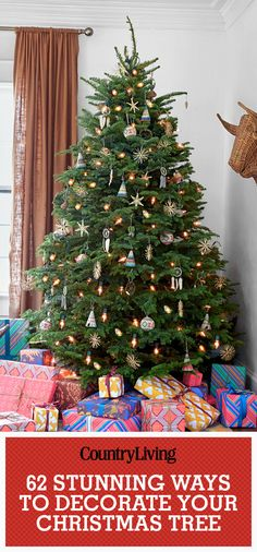 Don't forget to pin these great Christmas tree decorating ideas! Find more ideas by following our Country Living Pinterest boards!