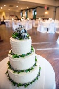 Buttercream cake, greenery and lavender, topped with good luck elephant cake topper.