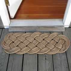 """Mystic Knotwork: Manila Door Mat Rug Prolong Knot 5 Pass. This serviceable but beautiful door mat takes over 120 feet of 1/2"""" manila rope to tie. It is about 41"""" long and 15"""" wide. Manila rope will last for decades and it beauty only improves with age. This rugged mat is good for wiping boots on at both the back door, and the front entryway."""