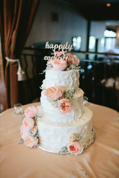 Pretty wedding cake with garden roses and dusty miller