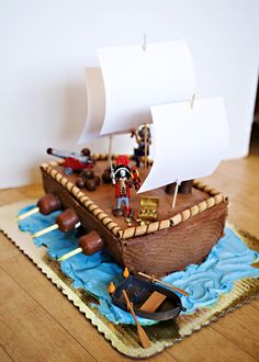 If you've ever been asked to do a pirate themed birthday party at your house. this Pirate Ship Cake could be perfect. I love how they've put the candles on the Pirate Birthday Cake, Boy Birthday, Birthday Ideas, Boys Birthday Cakes Easy, Pirate Ship Cakes, Pirate Ships, Easy Pirate Cake, Pirate Boat Cake, Pirate Theme