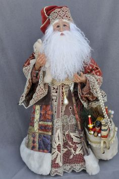 "Antique/vintage Santa, polymer clay, 19"" tall- used tapestries and vintage lace.  One of a kind."