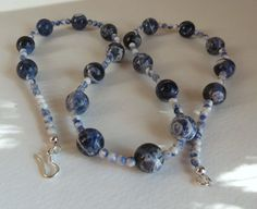A lovely and simple Sodalite necklace,  these stones are in beautiful blue and white shades.  What a perfect piece to wear to the office, date night, or just to make you feel pretty.  Great gift idea for that special person in your life.  #Jewelry, #HandmadeNecklace, #Sodalite, #BlueandWhite, #SemiPreciousStones