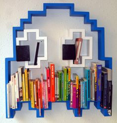Geek up your home with these retro Pac-Man style ghost bookshelves. Perfect for storing books, displaying pictures, and even scaring off interested dates you bring back home, these pixelated Pac-Man ghosts are a must have home accessory for grew up on the Pac Man, Home Design, Interior Design, Geek Mode, Deco Gamer, Bibliotheque Design, Game Themes, Gamer Room, Inspired Homes