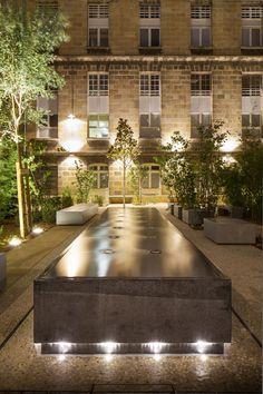 Cour Leyteire in Bordeaux, France by Debarre Duplantiers Associes Landscape Architecture, Landscape Design, Garden Design, Exterior Lighting, Outdoor Lighting, Modern Water Feature, Urban Heat Island, Design Light, Lighting Design