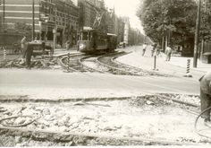 1939 - 1940. A view of the Oosterpark near the Linnaeusstraat in Amsterdam-Oost. On the tracks tram line 6. The Oosterpark is a large municipal park located in the Amsterdam-Oost/Watergraafsmeer borough of Amsterdam. The park has a large population of wild birds. Grey herons are the most visible. Many other birds have also nests in the park, so it is not difficult to observe them even during a short visit. Photo De Bock. #amsterdam #1940 #Oosterpark