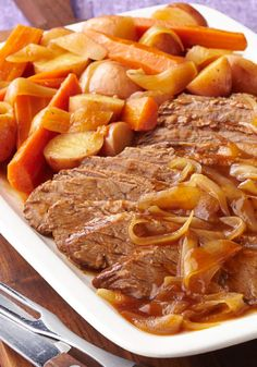 Slow-Cooker Barbecue Beef Brisket – When it comes to barbecue beef brisket, slow and steady wins the race. In this slow-cooker dish, it's prepared with carrots, onions and red potatoes.