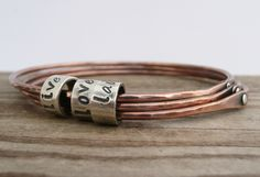 tube with writing on bracelet P1070802 by LauraBouton, via Flickr