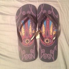 Flip flops a few different shades of purple Never worn size ten, lots of shades of purple Shoes