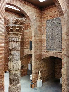 Towering arches of thin Roman brick line the inside of the National Museum of Roman Art.