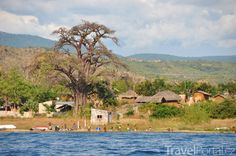 Small village at the edge of Niassa Reserve. Travel Deals, Tanzania, Statues, Tourism, River, House Styles, World, Places, Outdoor