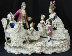 "A large Dresden Porcelain figural grouping depicting adults and children presenting flowers, various light damage on flowers and dresses, approximately 22"" long and 15"" high, circa mid/late 20th century"