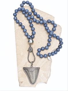 """An amazing ancient Megalodon shark tooth surrounded with sparkling diamonds, a large Tahitian pearl and huge diamond clasp are the focal points of this beautiful necklace. They are accented with silk-knotted natural blue coral orbs. The length of the coral necklace is 28"""". Measurement from the top of the pearl to the tip of the shark tooth is 5"""". The shark tooth measures 1.74"""" x 2.38"""". Absolutely one-of-a-kind."""
