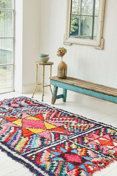 bright, Moroccan rug in the entryawy