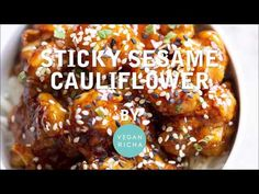 This Sticky Sesame Cauliflower is a crowd pleaser! Cauliflower is battered, baked, coated in sticky spicy sesame sauce & baked againn. Vegan Gluten-free Nut-free Recipe.