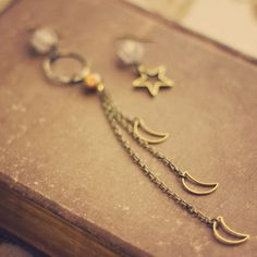 starlight.  a moon &star pair of asymmetrical by RootsandFeathers, $26.00