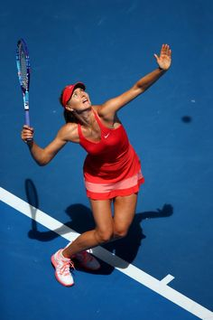 7bef702d4e2a9 Maria Sharapova Photos - Maria Sharapova of Russia serves in her fourth  round match against Shuai Peng of China during day seven of the 2015  Australian Open ...