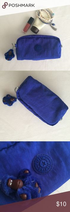 """Kipling cosmetic case Kipling cosmetic/pencil case in royal blue, measures approx. 6""""w x 3""""h x 2""""d, includes monkey charm, super cute! Excellent used condition, only used a handful of times. Kipling Bags Cosmetic Bags & Cases"""