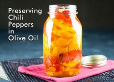 Learn how to preserve your chili peppers in olive oil so you can enjoy them all year long. They're like summer in a jar.