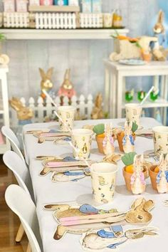 Take a look at the lovely table settings at this Peter Rabbit birthday party See more party ideas and share yours at CatchMyParty.com #catchmyparty #partyideas #4favoritepartiesoftheweek #paterrabbit #peterrabbitparty #1stbirthdayparty