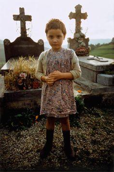 Girl in the cemetery, Béhorléguy, France, 1967.  william albert allard.